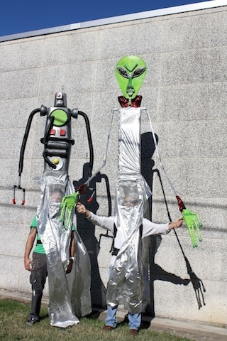 robot-and-alien-puppet-outside